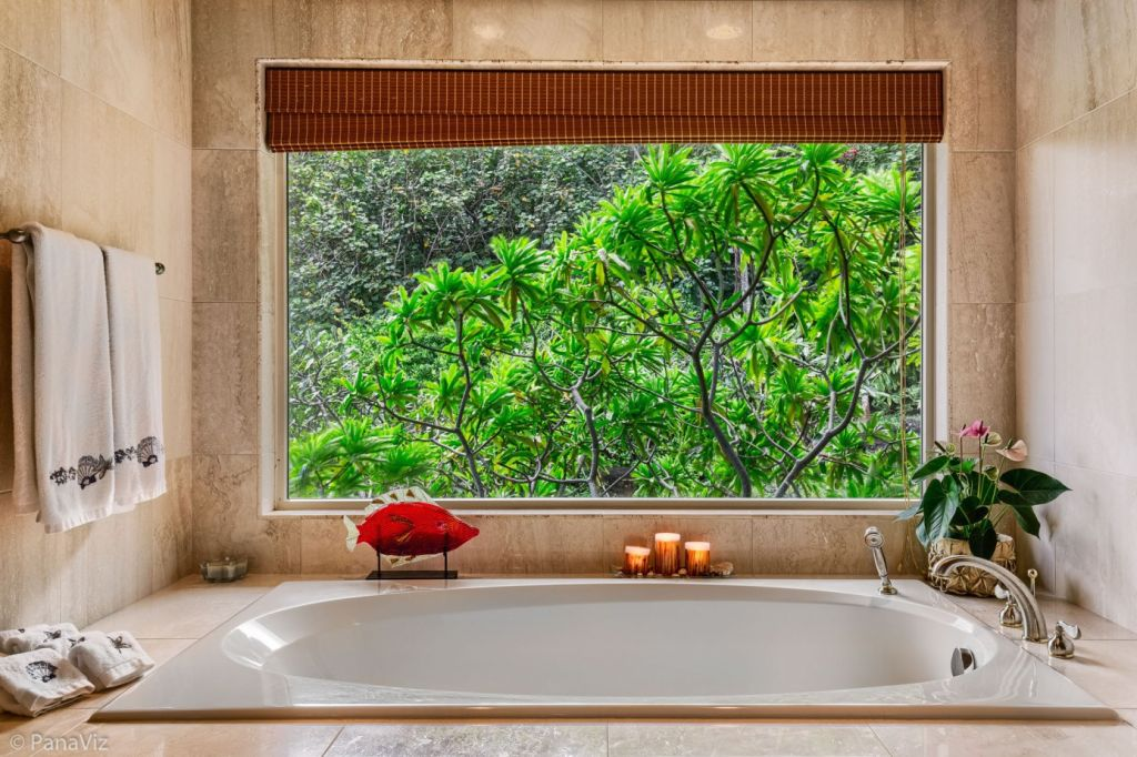 A bath with a jungle view